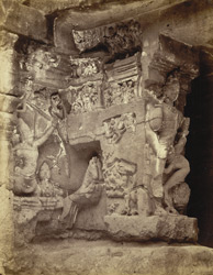 [Sculptured panel of Shiva riding in a chariot, on the north side of the entrance to Cave XVI (Kailasanatha), Ellora.]